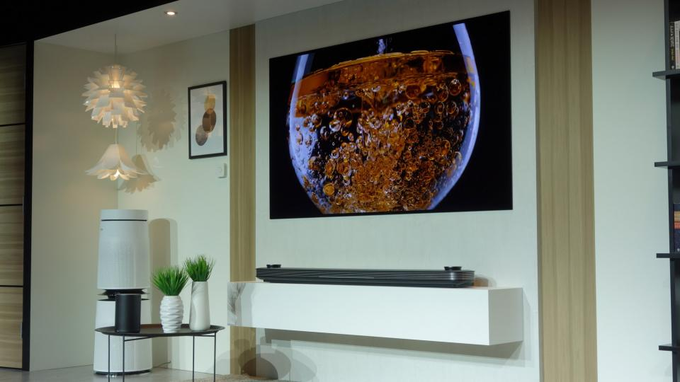 LG unveils radical 65inch TV you can roll up like a poster
